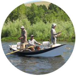 Custom guided fly fishing clients in guide's boat